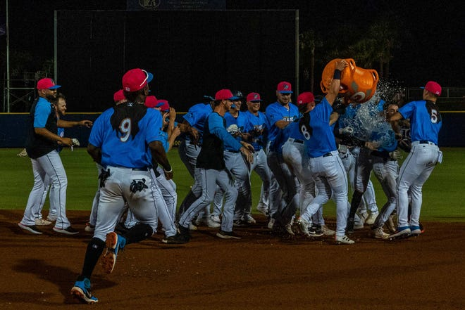 The Pensacola Blue Wahoos celebrate a walkoff win over the Chattanooga Lookouts on July 15, 2021.