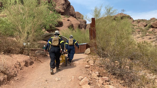 Members of the Phoenix Fire Department's Technical Rescue Team begin a mountain rescue on Echo Canyon Trail at Camelback Mountain on July 11, 2021.