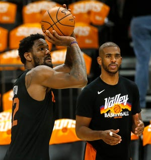 July 16, 2021; Phoenix, Arizona, USA; Suns' Deandre Ayton shoots as Chris Paul watches during practice at the Footprint Center in Phoenix. Patrick Breen-The Republic
