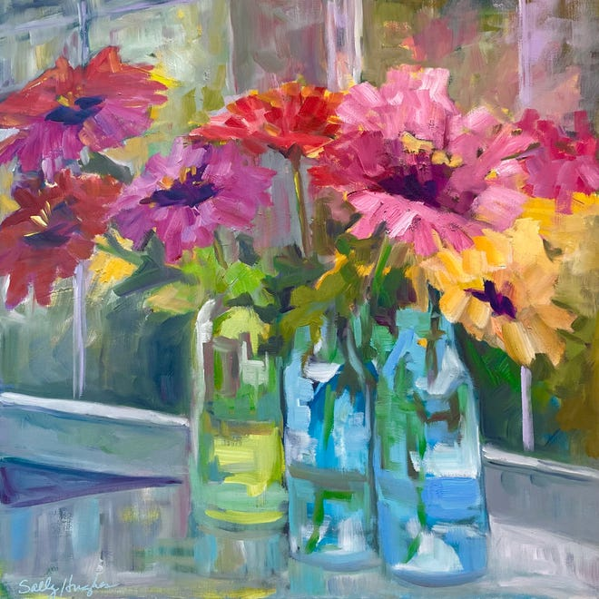 """""""Zinnias and Glass"""" is an oil painting by Sally Hughes that's part of the """"A Year of Reflection"""" exhibit at Reid Health's MacDowell Gallery."""