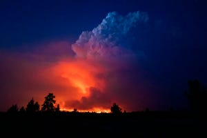 Flames and smoke rise from the Bootleg fire in southern Oregon on Wednesday, July 14, 2021.