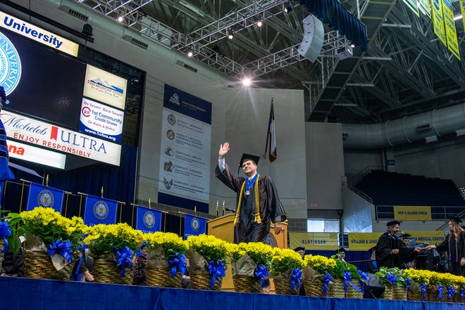A graduate walks the stage during Angelo State University's commencement ceremonies in spring 2021.