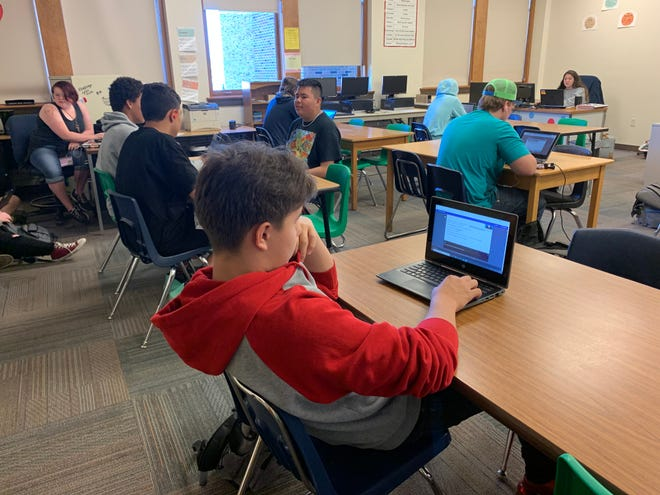 Students use computers to learn during a summer school program offered by the Rapid City school system in an attempt to stay on track or catch up on learning missed during the COVID-19 pandemic.