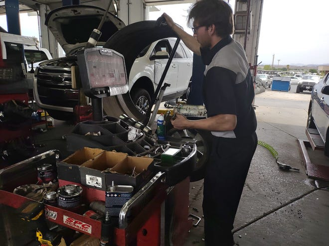 McKade Fielding, a tire tech at Big-O Tires in St. George, works in an auto shop on Wednesday, July 14, 2021.