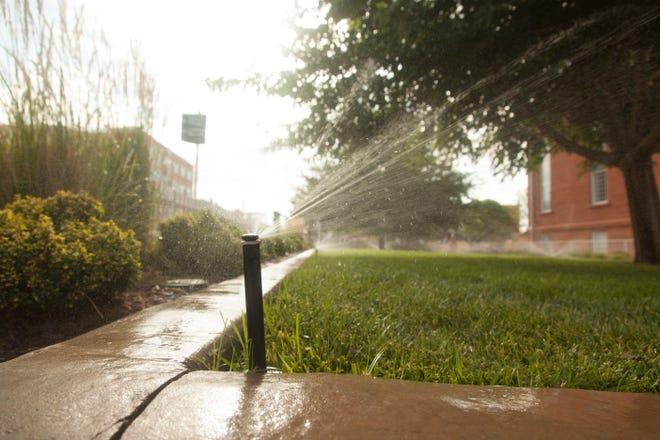 Sprinklers run in downtown St. George Saturday, July 3, 2021.