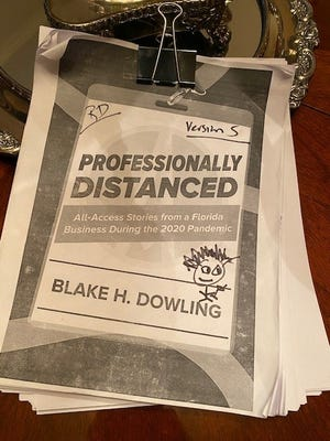 Blake Dowling has taken his top 20 columns from 2020 and wrote some introductions to compile into a book, shown here as a worn working copy of his pandemic book project, version 5.