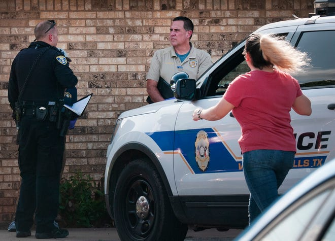 Wichita Falls Police work the scene of a shooting death Thursday.