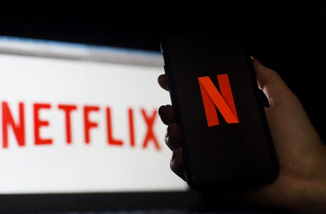 In this photo illustration a computer and a mobile phone screen display the Netflix logo on March 31, 2020 in Arlington, Virginia.