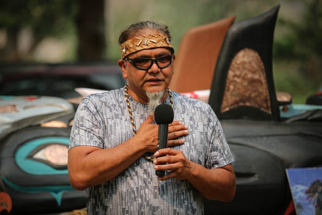 Lummi totem carver Phreddie Lane speaks on July 15 at Snake River Canyon Station in Idaho, on the Red Road to DC tour, which finds dozens of Native American activists driving 25-foot-high racetracks to highlight the need to protect the holy site.