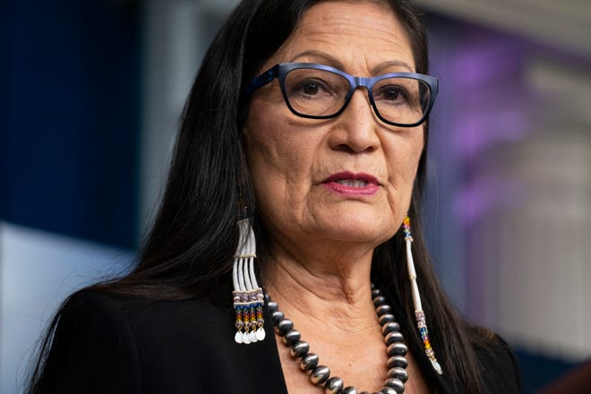 Home Secretary Deb Haaland speaks during a news briefing at the White House in Washington.  Many Native American activists say they know that the Pueblo Lagoon native has a mandate to serve all voters, but they hope her sensitivity to indigenous issues will help their efforts to preserve the holy land and increase economic opportunity.