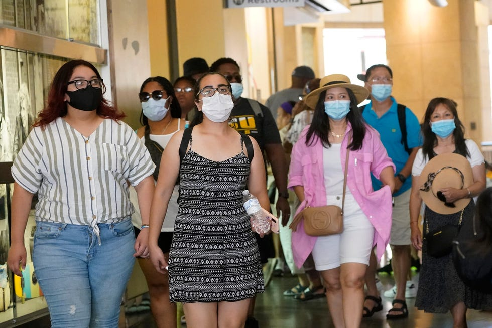 Visitors wear masks as they walk in a shopping district, in the Hollywood section of Los Angeles on July 1, 2021. Coronavirus cases have jumped 500% in Los Angeles County over the past month and health officials warned Tuesday, July 13, 2021, that the especially contagious delta variant of the disease continues to spread rapidly among California's unvaccinated population.