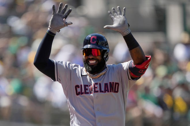 Cleveland designated hitter Franmil Reyes celebrates after hitting a home run in the eighth inning of a 3-2 win over the Oakland Athletics on Saturday. [Tony Avelar/Associated Press]
