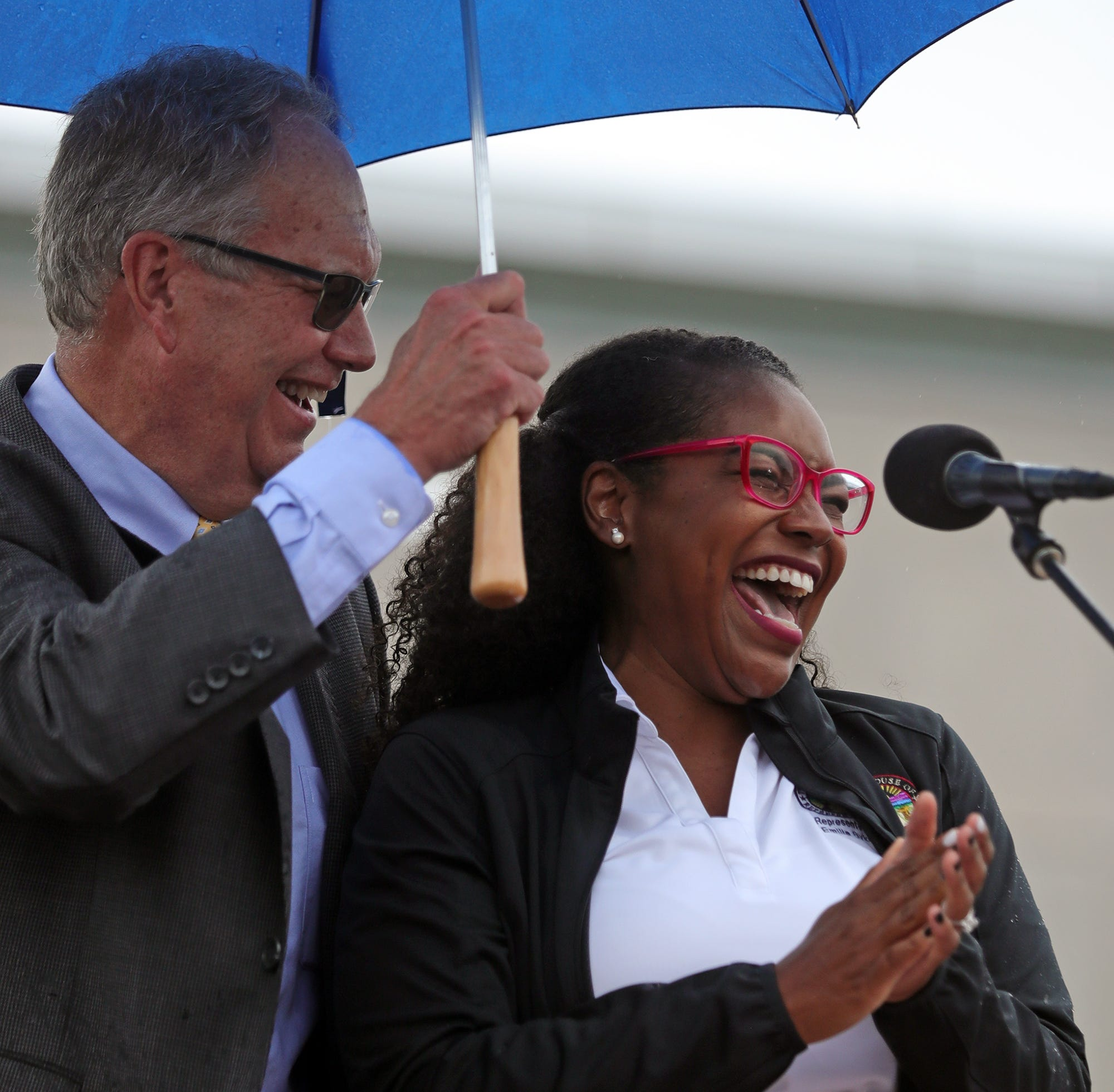 Stow Mayor John Pribonic shares a laugh with Rep. Emilia Sykes during a July 17 dedication ceremony for the John Lewis Memorial Bridge in Stow.