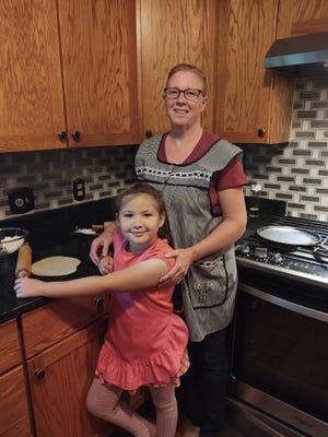 Anita Ramirez and her daughter, Anna, make tortillas in the kitchen of their MIfflin home.