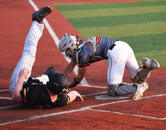 Ames catcher Brady Burkheimer tags out Southeast Polk's Matt Rivers at the plate during the Little Cyclones' 12-2 loss to the Rams in the first round of Class 4A substate competition Friday at Pleasant Hill.