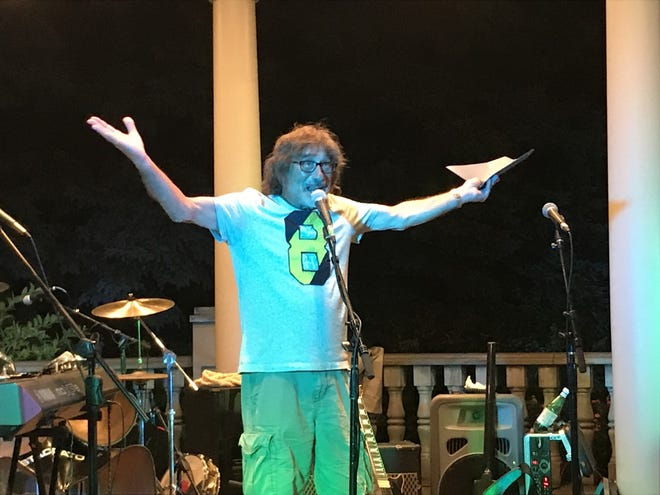"""Donnie Iris says, """"What I do?"""" as he receives a proclamation Friday from Beaver's mayor for Donnie Iris Day."""