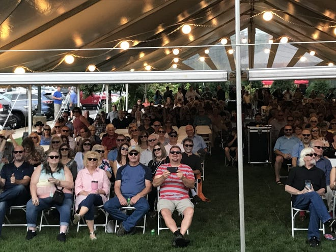 """A sold-out crowd of 325 people received free Donnie Iris-style glasses Friday night at the Beaver Valley rock star's concert with the Granati Brothers at Beaver Station Cultural and Event Center. Dr. John Guzzetti, a Vanport Township optometrist, provided the glasses that say """"King Kool,"""" riffing off Iris' nickname."""