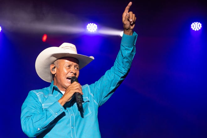 Neal McCoy sings to the crowd at the Blame My Roots Festival at the Valley view Campground in Belmont.