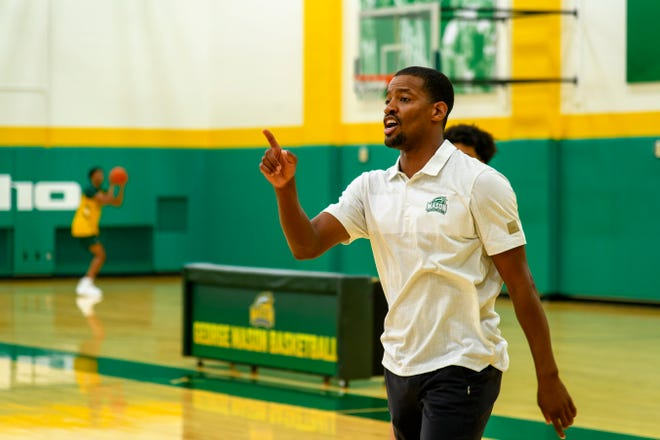 George Mason head coach Kim English gives instructions during offseason practice. English, a former Missouri star, was hired as the Patriots' head coach in March.