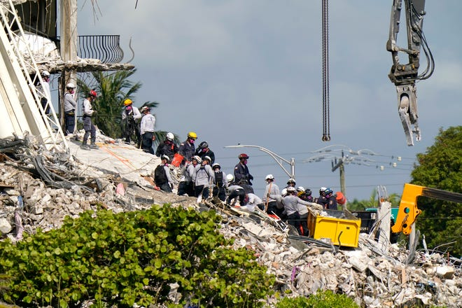 Rescue workers search in the rubble at the Champlain Towers South condominium on  June 28.