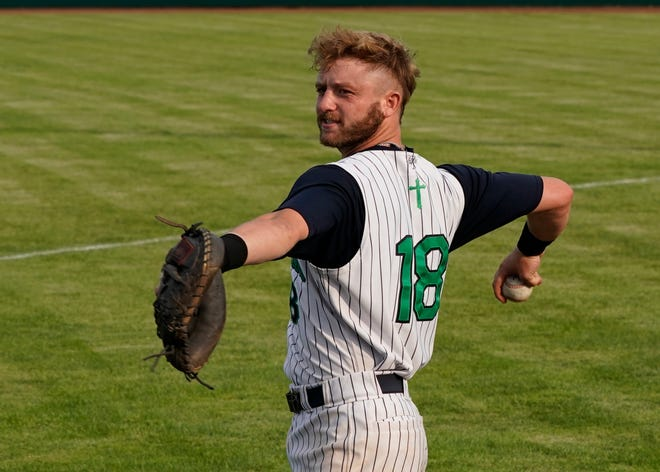 Michigan Monarchs catcher Josh Beck (University of Akron/Ottawa Lake Whiteford) throws the ball around before Wednesday's game against the Royal Oak Leprechauns at Siena Heights.
