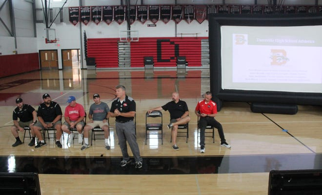 Dansville Superintendent Dr. Paul Alioto sets up a presentation on the merger of the Dansville and Way-Co football programs on Wednesday in Dansville.
