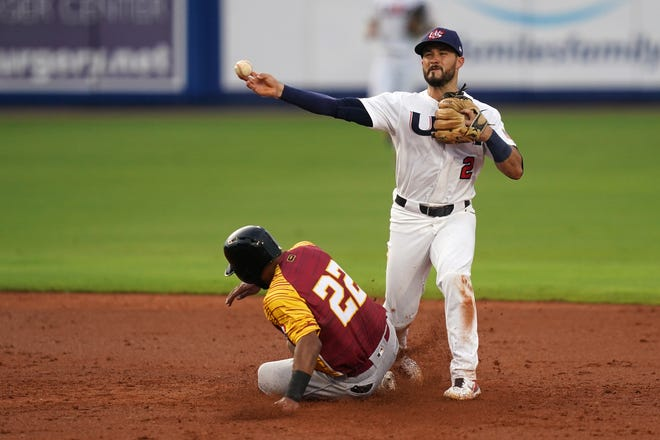 United States second baseman Eddy Alvarez (2) gets the force out of Venezuela third baseman Ali Castillo (22) while turning a double play in the Super Round of the WBSC Baseball Americas Qualifier series in Port St. Lucie.