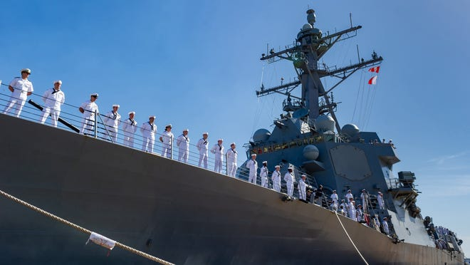 Crew members of the USS Thomas Hudner (DDG 116) line the rail of the Arleigh Burke-class guided-missile destroyer as it returned to its homeport of Naval Station Mayport on Saturday morning after its maiden deployment. It supported operations in the 5th and 6th Fleet areas of responsibility.