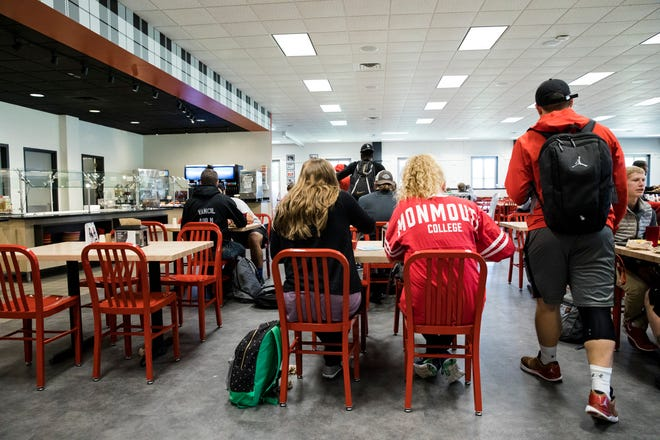 Monmouth College students gather in a dining room in this file photo. Area colleges and universities are strongly encouraging students to get vaccinated prior to the start of classes this fall.