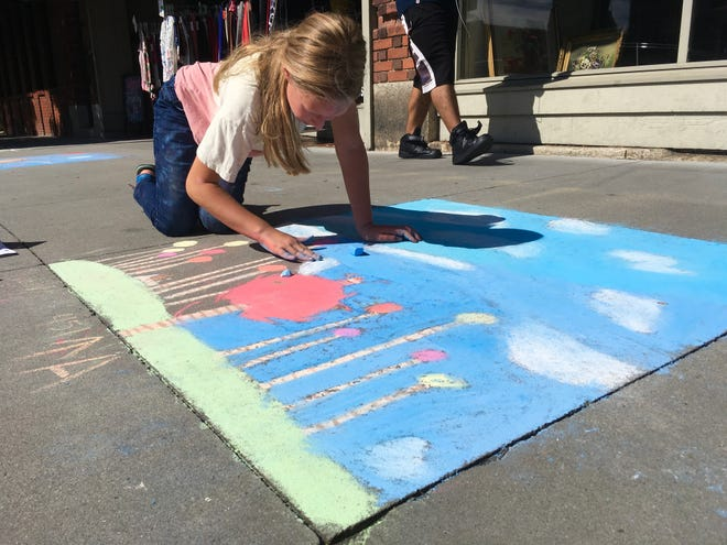 Daisy Dirks, 10, takes part in the 25th annual Chalk It Up! on Main Street in Hendersonville.
