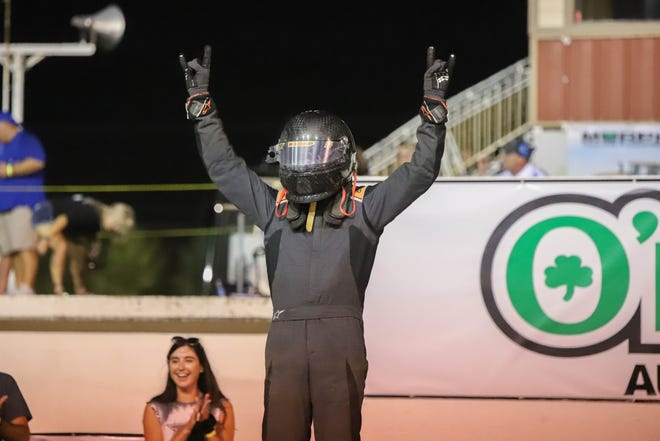 Kendall Kemp celebrates after winning the AAA modifieds division race at the 65th Hutchinson Grand Nationals auto races at the Kansas State Fairgrounds Friday, July 16, 2021.
