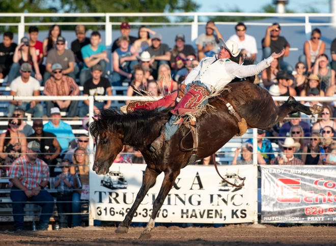 """Blaine Kaufman of Pretty Prairie, stays on """"On Tap With Nutrena"""" for a score of 8.6 points promoting him to the top spot in the Bareback Riding at the Pretty Prairie Rodeo, Saturday, July 20, 2019."""
