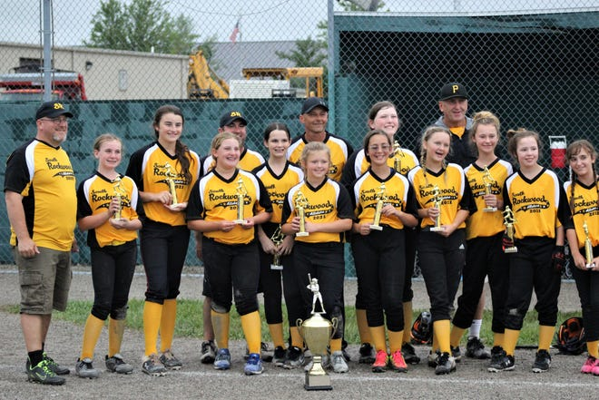 South Rockwood poses with the championship trophy after defeating Summerfield 10-0 in the finals of the Monroe County Fair Softball Tournament on Friday, June 16, 2021.