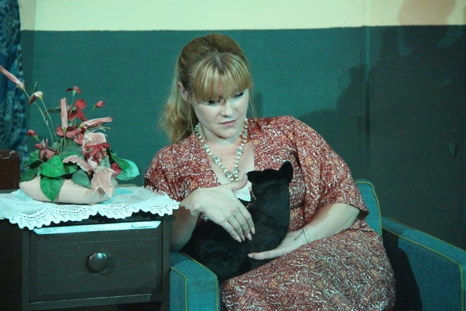 """Gillian (Annie Busby) casts a spell with the help of her cat Pyewacket in CLOTA's upcoming production of """"Bell, Book and Candle."""""""