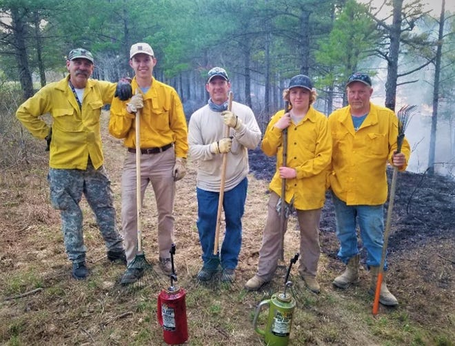 Members of the Foothills Prescribed Burn Association pose for a photo during a prescribed burn. During its first three months, Foothills Prescribed Burn Association  safely completed 12 prescribed burns and improved more than 90 acres of habitat.