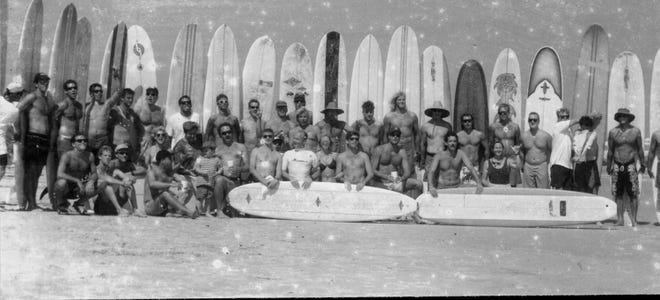 A photograph from the St. Augustine Historical Society's St. Augustine Surf Culture Archives shows a group of surfers in the 1990s.