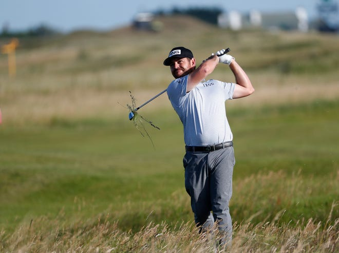 Louis Oosthuizen plays out of the rough during the third round of the British Open Golf Championship at Royal St George's on Saturday.