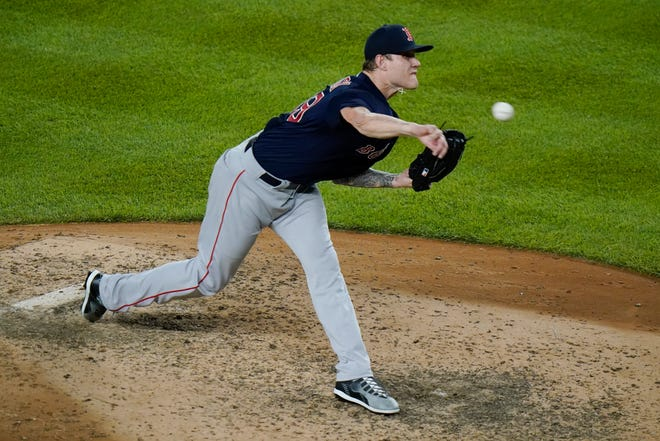 Boston Red Sox's Tanner Houck delivers a pitch during the Red Sox's 4-0 win against the New York Yankees in New York.