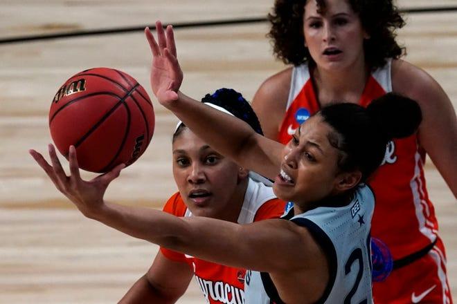 UConn forward Olivia Nelson-Ododa, front, beats Syracuse center Kamilla Cardoso, middle, and guard Tiana Mangakahia, back, to a rebound during the NCAA Tournament last season.