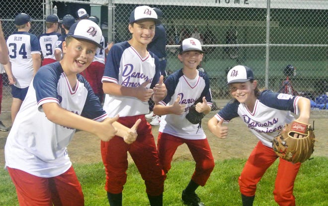 Danvers American Little League Williamsport all-stars George O'Brien, Damon Mataragas, Eli Tibbetts and Chase Horenstein, from left, celebrate the team's District 15 victory over Gloucester Friday night at Beverly's Harry Ball Field. The Danvers boys won the close encounter, 1-0, and now move on to the State Section 4 Tournament Wednesday, July 21, against Reading, the District 13 champs, at Beverly again.