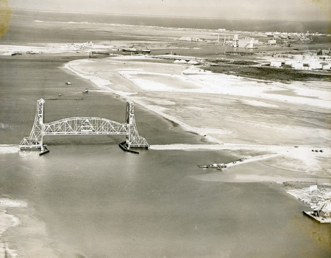 The Tule Lake Lift Bridge carried rail and vehicle traffic over the upper harbor at the Port of Corpus Christi. The bridge, seen here in 1959, the same year it opened, cost about $6.3 million.