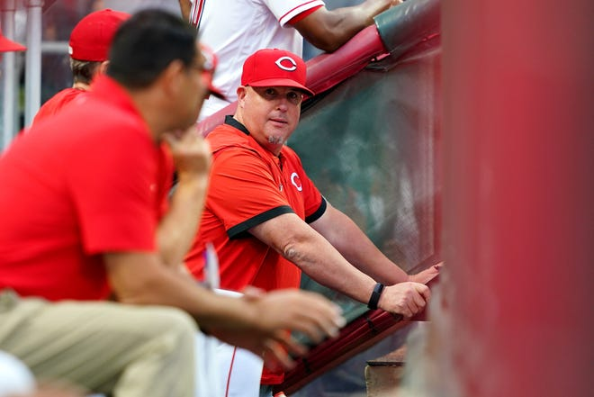 Cincinnati Reds pitching coach Derek Johnson (36) observes the game during the third inning of a baseball game against the Milwaukee Brewers, Friday, July 16, 2021, at Great American Ball Park in Cincinnati. The Milwaukee Brewers won, 11-6.