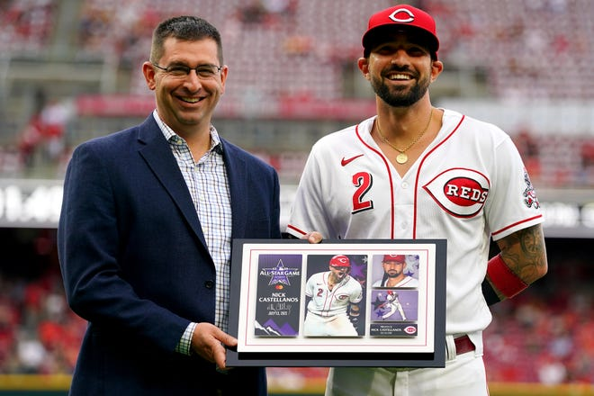 Cincinnati Reds right fielder Nick Castellanos (2) is presented with an All-Star plaque by Cincinnati Reds general manager Nick Krall prior to the start of a baseball game against the Milwaukee Brewers, Friday, July 16, 2021, at Great American Ball Park in Cincinnati. The Milwaukee Brewers won, 11-6.