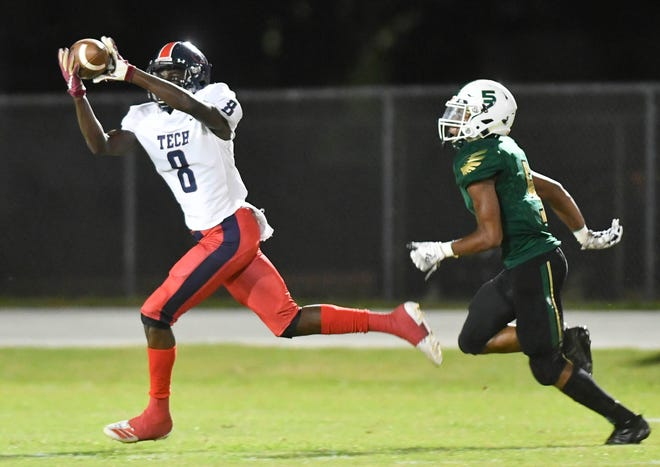 Iowa State recruit Greg Gaines of Tampa Bay Tech catches during a Florida state high school playoff game.