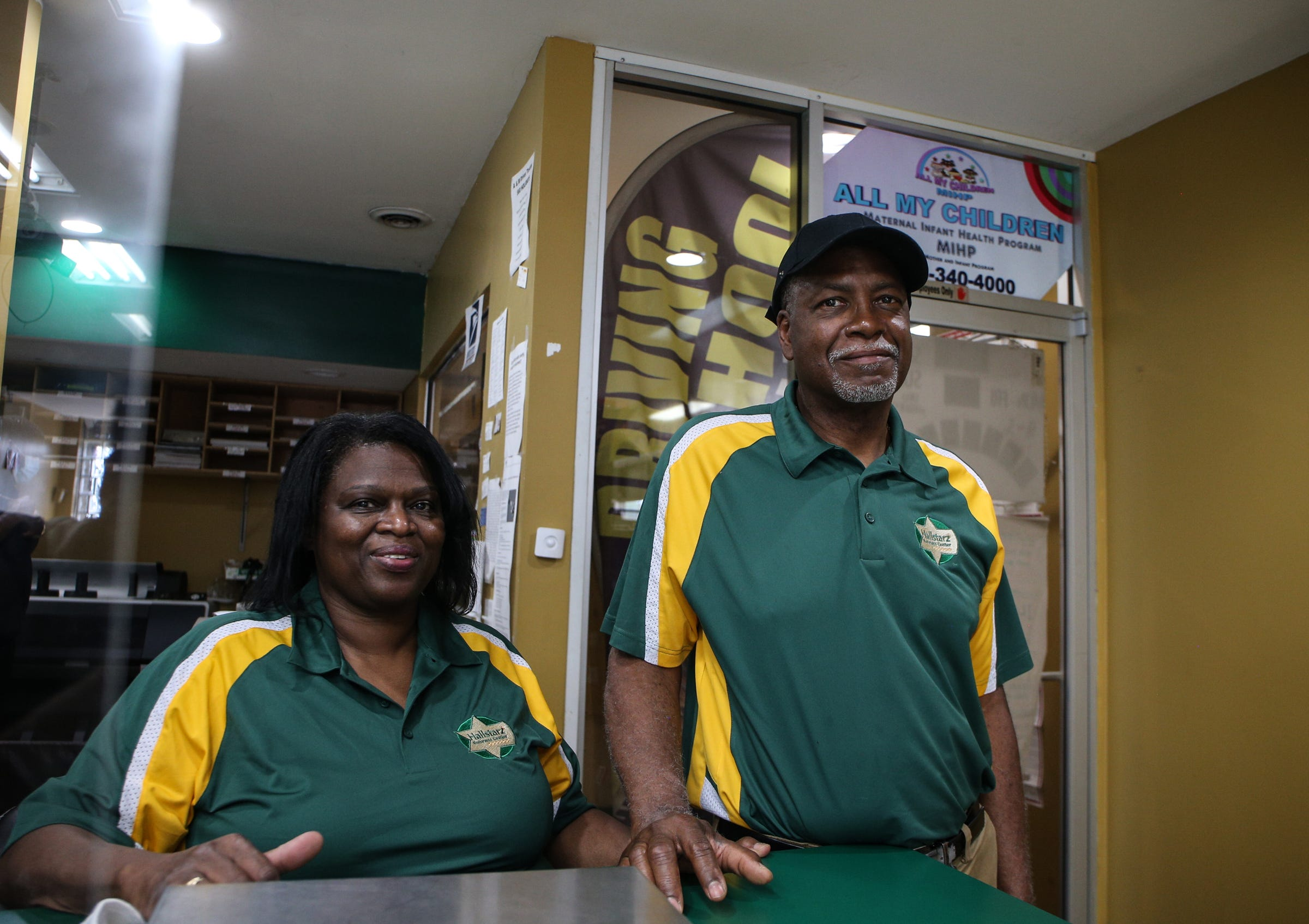 Vanessa Hall and Milton Hall Jr. pose for a photo inside of Hallstarz Business Center in Detroit on July 15, 2021. The business center is a one-stop-shop in the Bagley neighborhood. A neighborhood source for packing, shipping, printing and other business services. Created 36 years ago by a Detroit couple, Milton Hall Jr. and Vanessa Hall. The business is now run by their oldest son, Mario Hall with help from his five brothers.