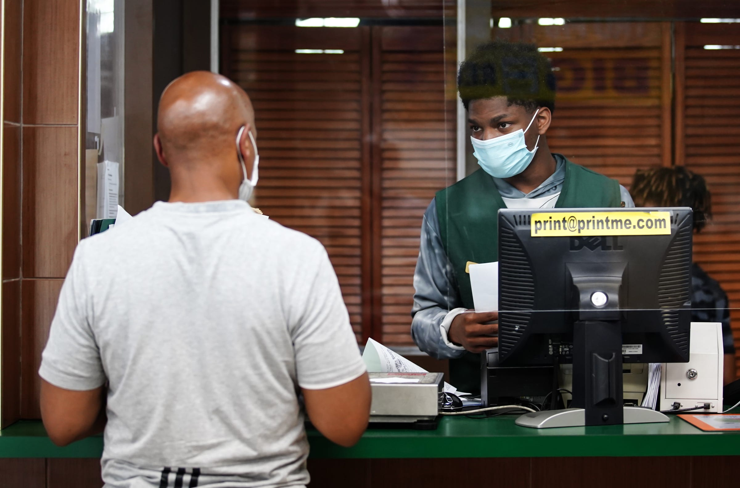 Jazel Hall, 19, of Detroit helps customers at Hallstarz Business Center in Detroit on July 15, 2021. The business center is a one-stop-shop in the Bagley neighborhood. A neighborhood source for packing, shipping, printing and other business services. Created 36 years ago by a Detroit couple, Milton Hall Jr. and Vanessa Hall. The business is now run by their oldest son, Mario Hall with help from his five brothers.