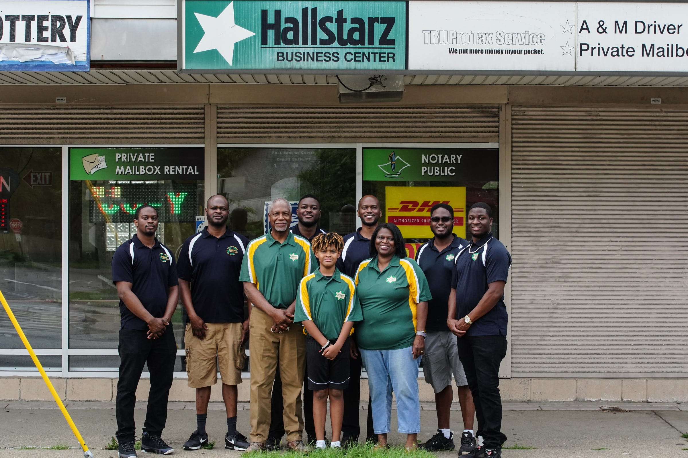 (Front to Back, L to R) Marquis Jr., 10, Milton Jr., 65, Vanessa, 66, Mylan, 32, Marquis, 44, Martez, 31, Mario, 45, Milton lll, 38, and Malik Hall, 26, in front of Hallstarz Business Center in Detroit on Thursday, July 15, 2021. The business center is a one-stop-shop in the Bagley neighborhood. A neighborhood source for packing, shipping, printing and other business services. Created 36 years ago by a Detroit couple, Milton Hall Jr. and Vanessa Hall. The business is now run by their oldest son, Mario Hall with help from his five brothers.