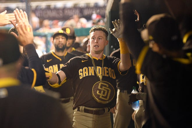 San Diego Padres' Jake Cronenworth celebrates in the dugout after his home run during the fifth inning of a baseball game against the Washington Nationals, Friday, July 16, 2021, in Washington.