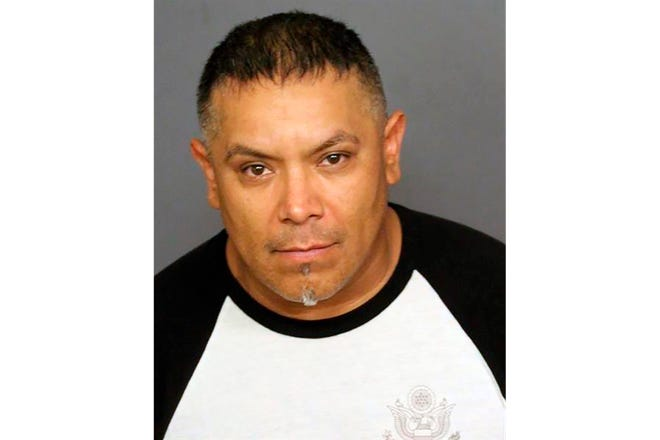 This booking photo provided by the Denver Police Department shows Ricardo Rodriguez.