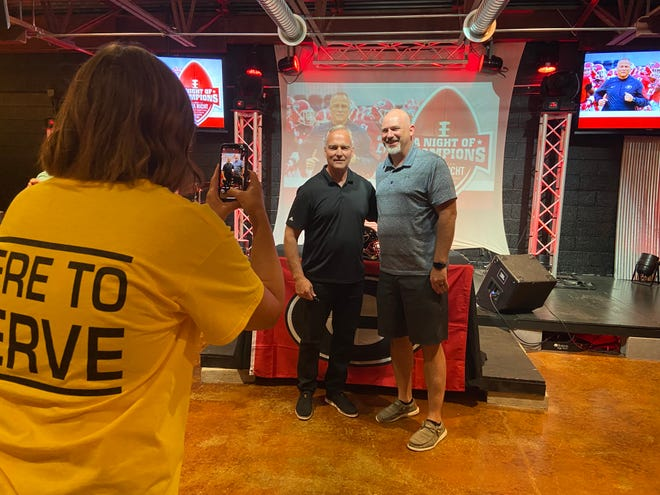 Former Georgia and Miami head football coach Mark Richt takes a picture with Bradford Principal Shane Paschall before Richt spoke to 16 football teams from rural West Tennessee at First Baptist Church of Milan on Friday, July 16, 2021.